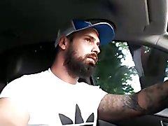 Bearded tattooed guy jerking off